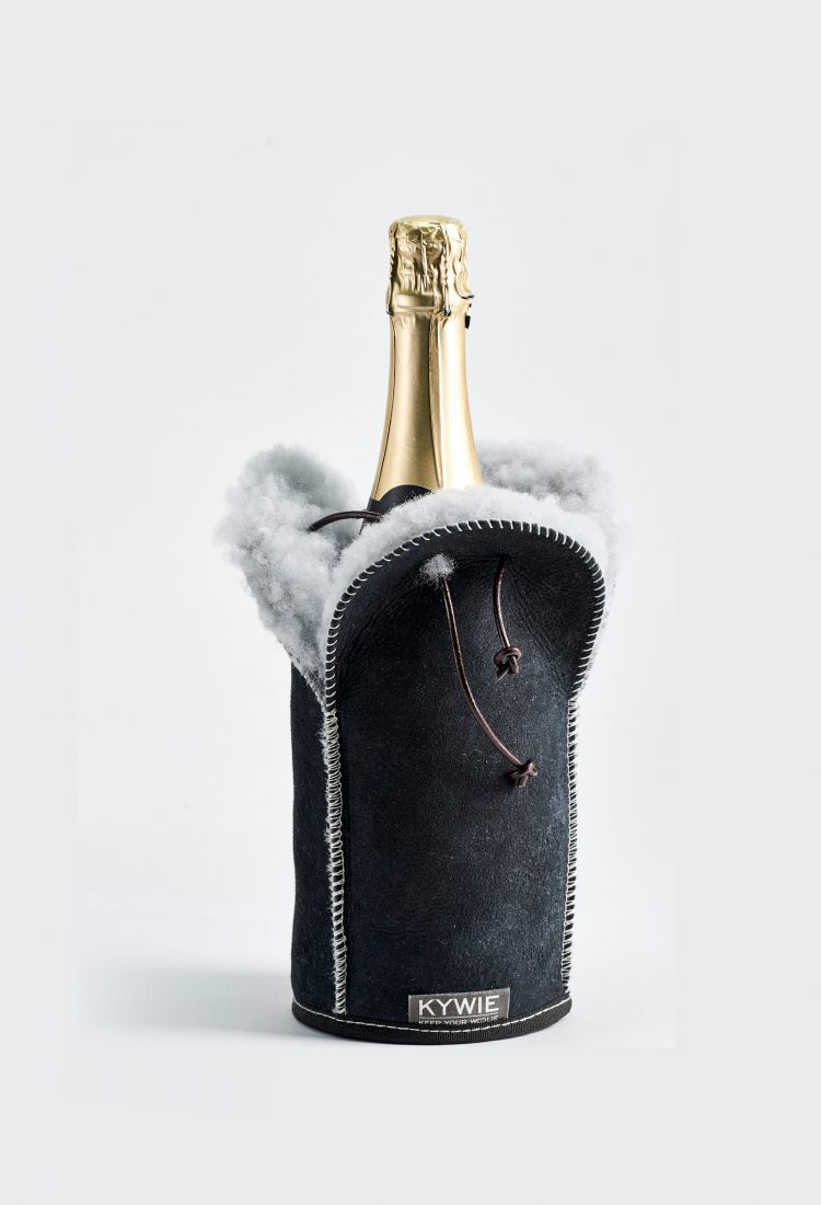champagne and wine cooler make of sheepskin with Taittinger champagne on the table