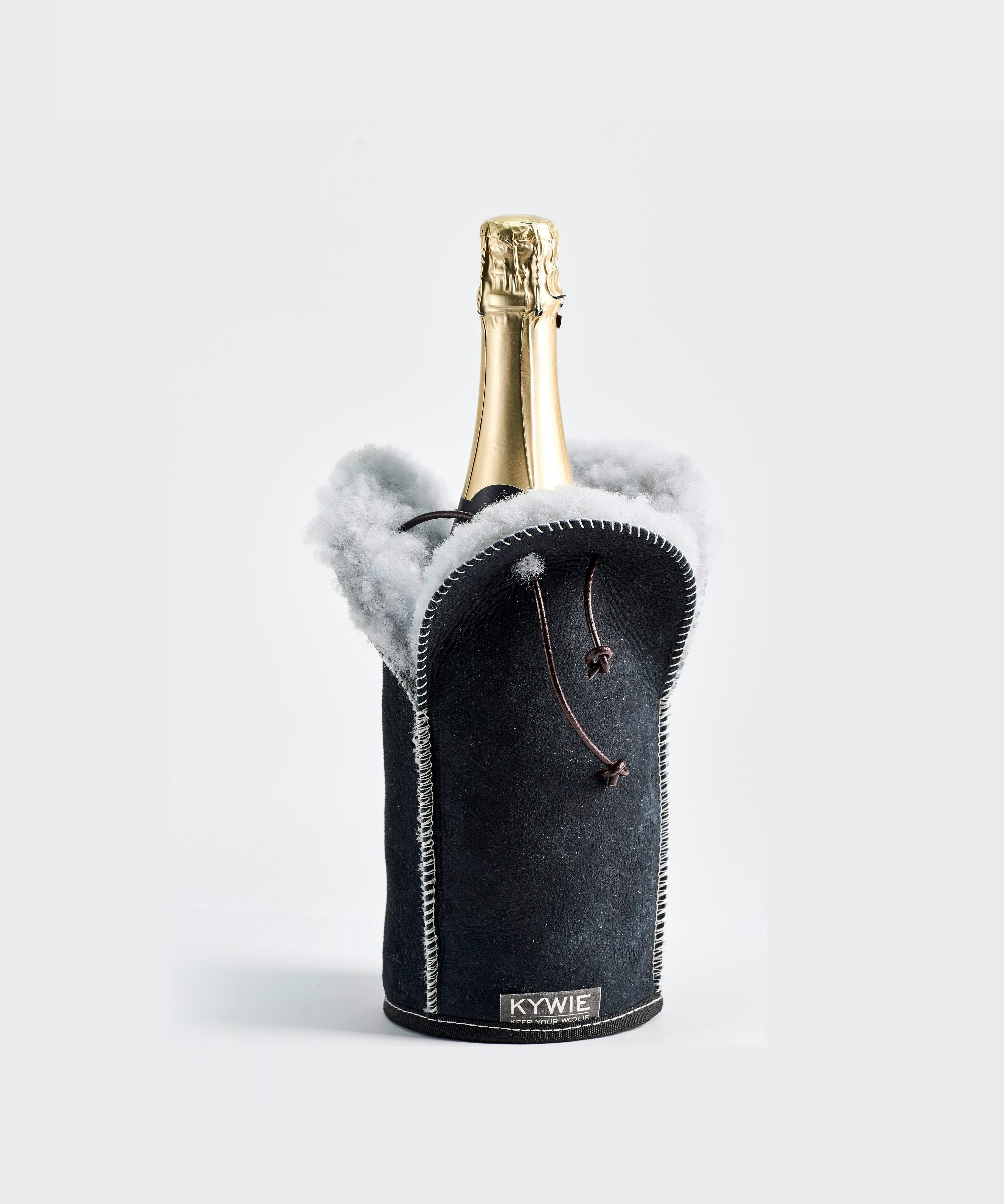 champagne bottle insertion champagne and wine cooler make of sheepskin with Taittinger champagne on  the table