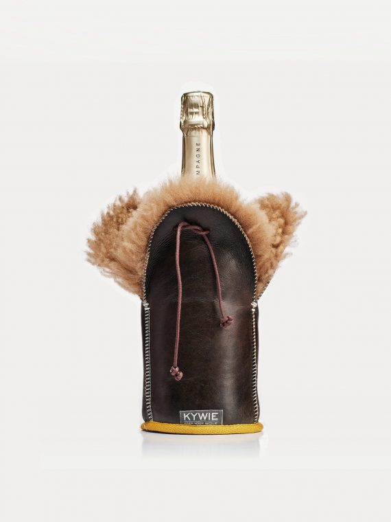 a bottle of champagne in a woolen tote, keeping the bottle ice-cold
