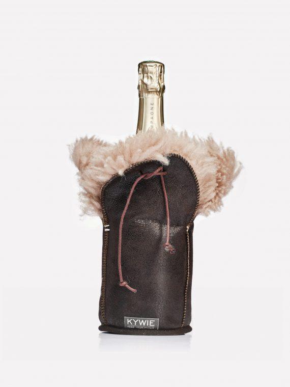 cold champagne bottle inside a woolen kywie cooler made of sheepskin