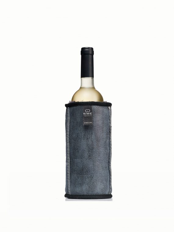 sheepskin wine cooler with grey leather treatment and a bottle of cool white wine